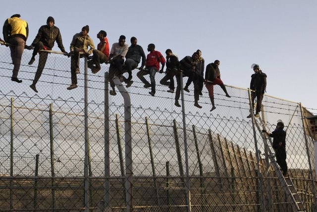 Illegals jumping a border fence